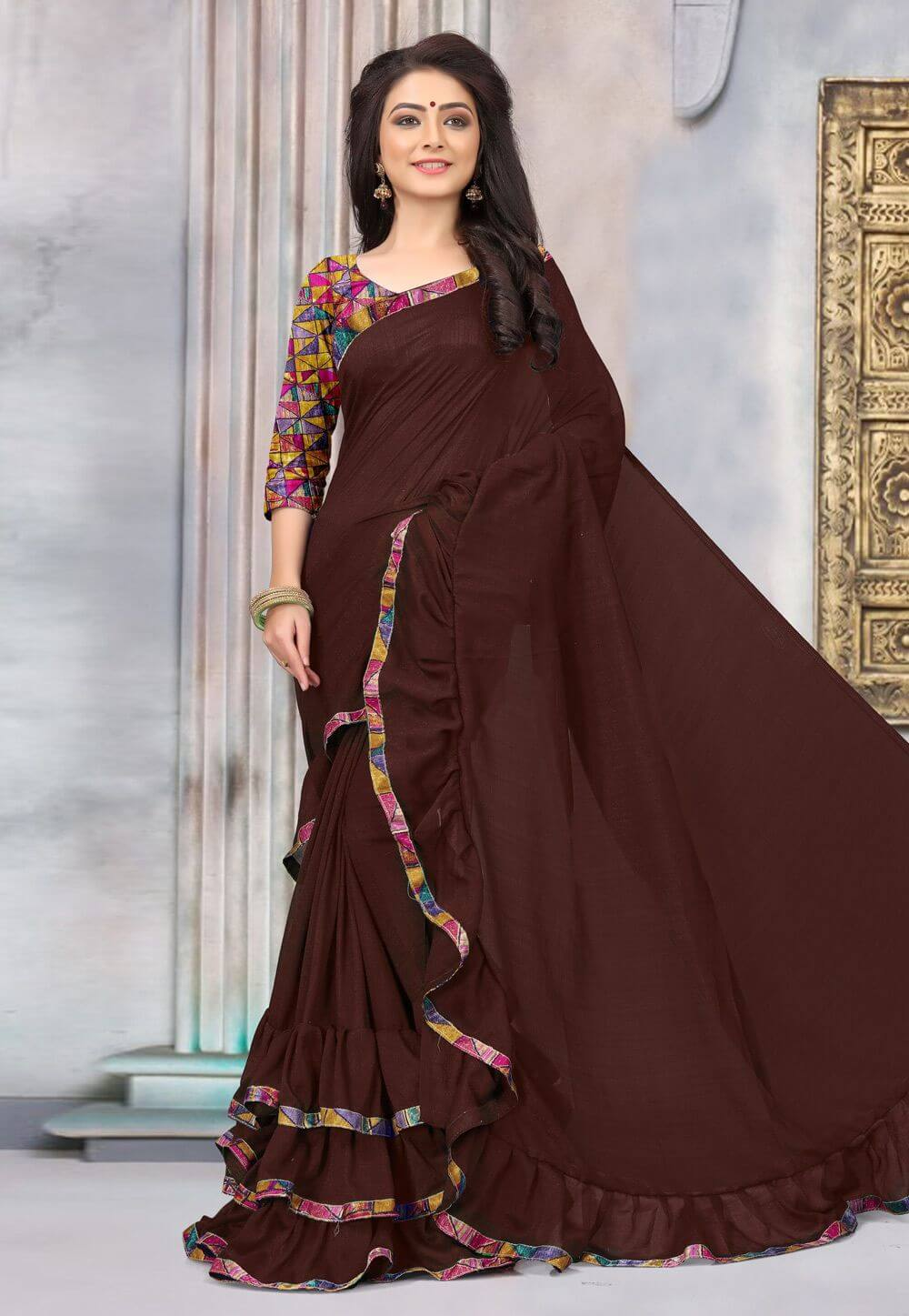 Brown Saree with printed blouse: